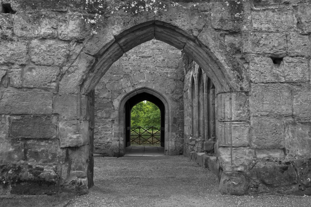 A view through the arches Bodium Castle by bizziebeeme