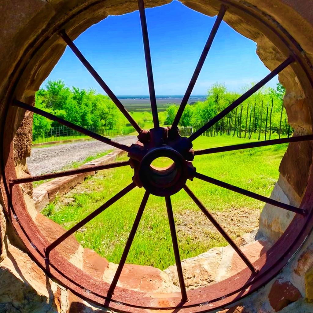 The fence wagon wheel  by louannwarren