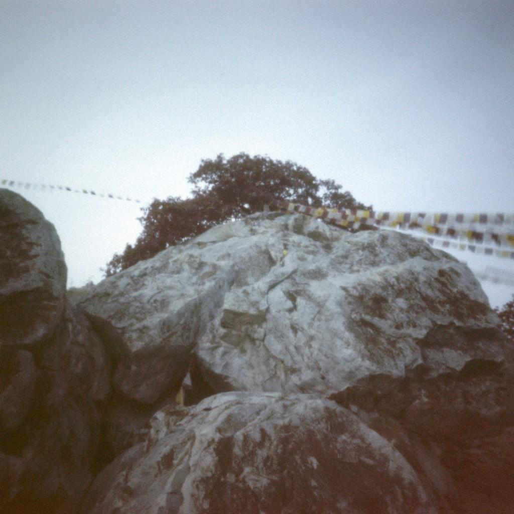 Prayer flags and rocks by peterdegraaff