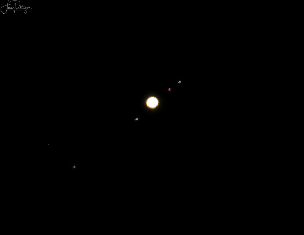 Jupiter and Its Moons by jgpittenger