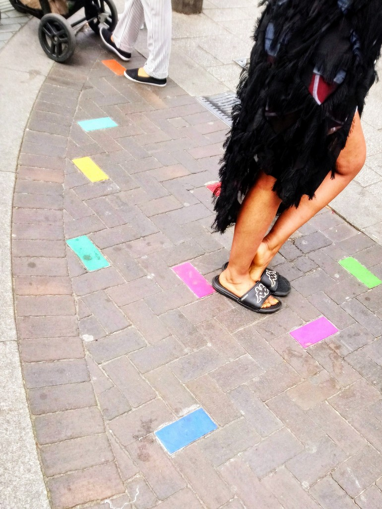Feet and coloured paving by boxplayer