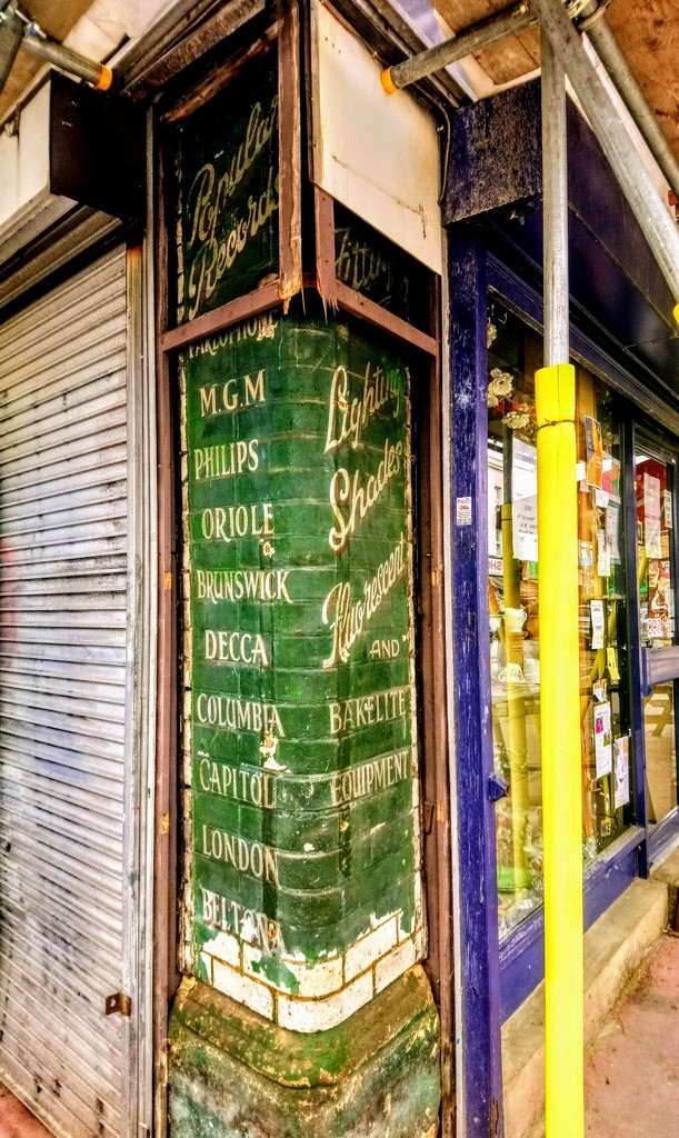 Ghost sign on green bricks by boxplayer