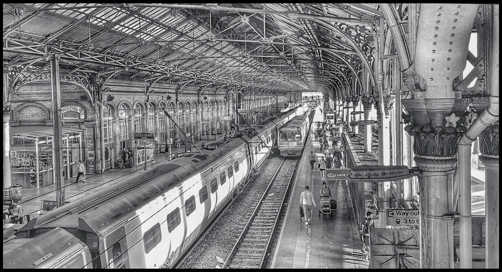 I always have to sneak a pic of the train station from the bridge on the way home by lyndamcg