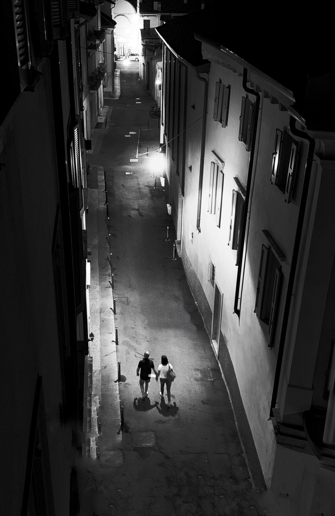couple under the lamp. by caterina