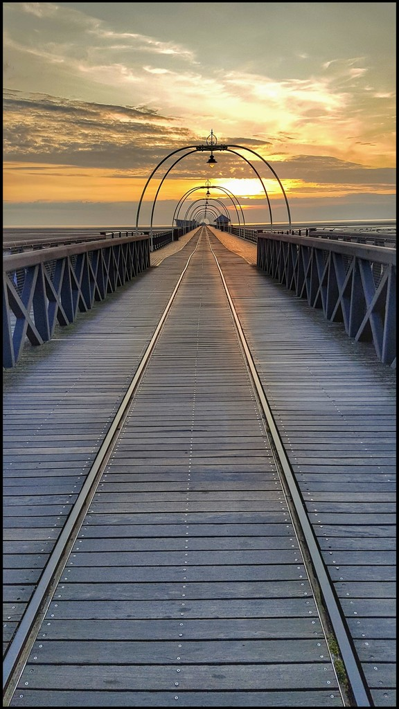 Southport pier as the sun goes down by lyndamcg