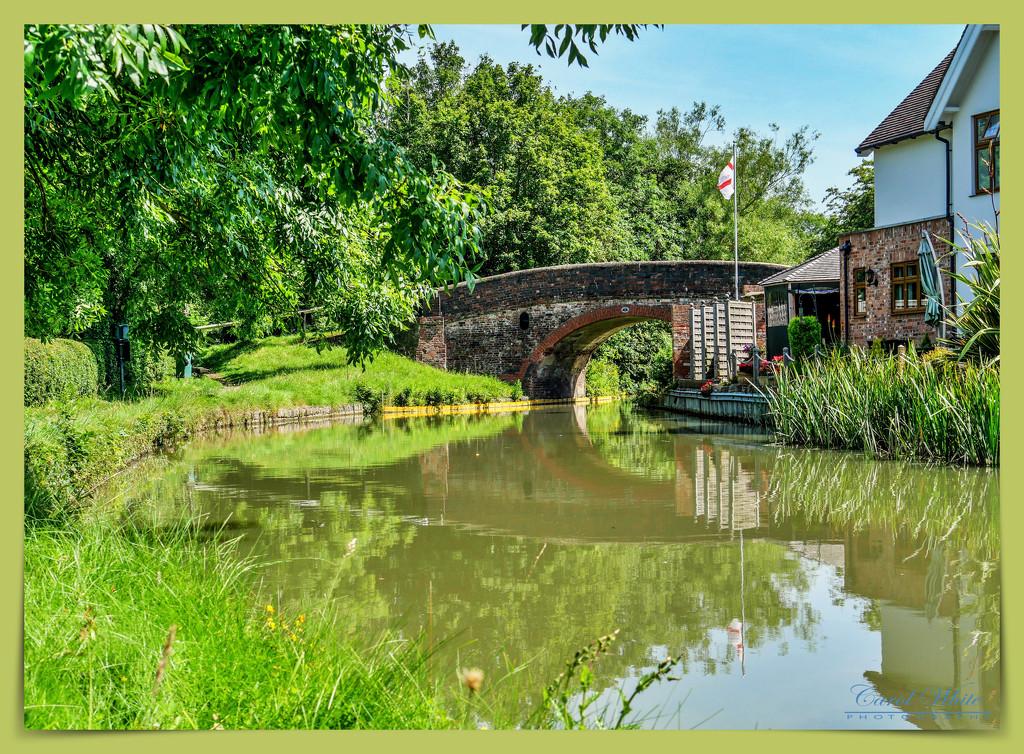 Canal Bridge And Reflections by carolmw