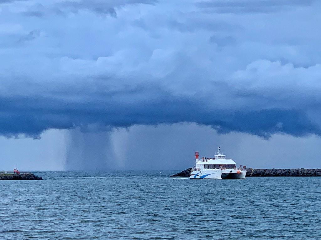 Rain chasing a boat.  by cocobella