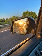 13th Aug 2019 - Sunset in the rearview mirror.