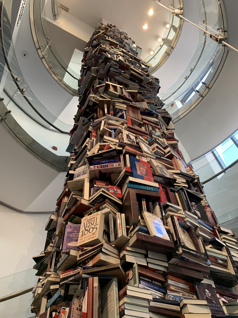 Tower of books featuring Lincoln by kdrinkie
