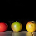 On the kitchen counter - six apples and a tomato by vignouse