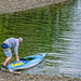 Man Readies His Canoe for Boarding
