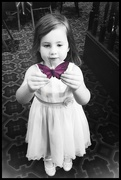 3rd Sep 2019 - My youngest granddaughter holding one of the butterfly decorations at the memorial service.