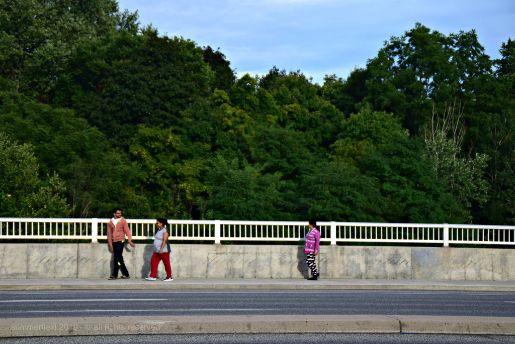 people on sidewalk by summerfield