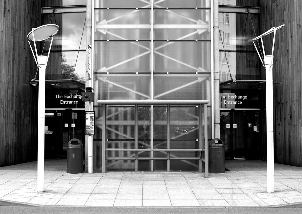 Symmetrical Bus Stop (vintage lens shot) by phil_howcroft