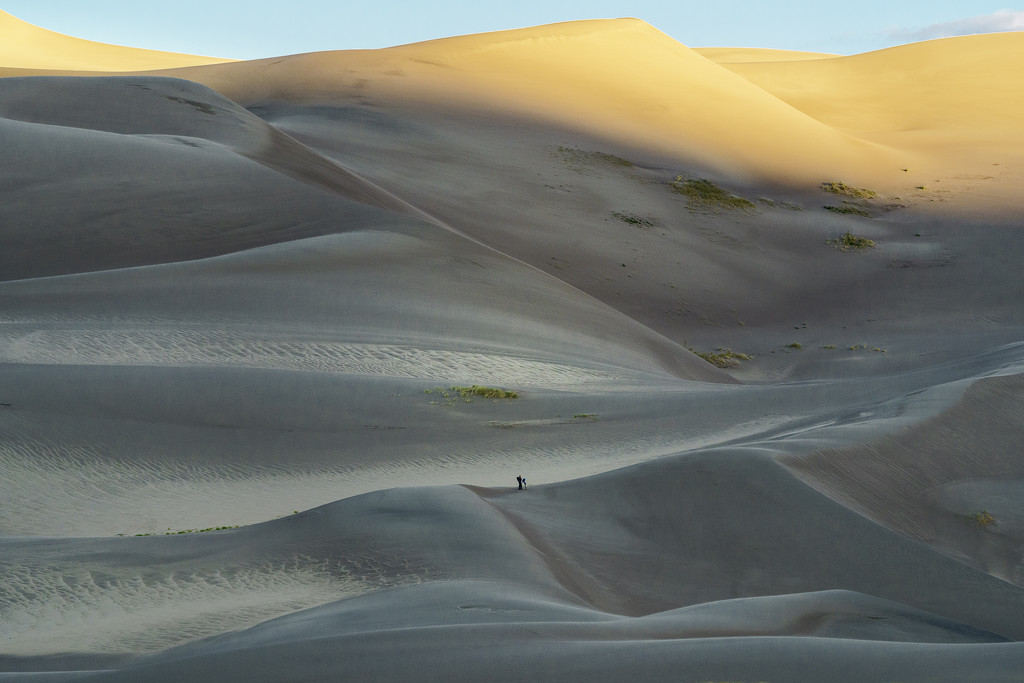 Photographer As the Morning Light Touches the Top Of the Dunes by jgpittenger
