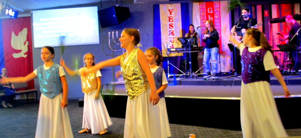 Children dancing to celebrate The Feast of Tabernacles by 777margo