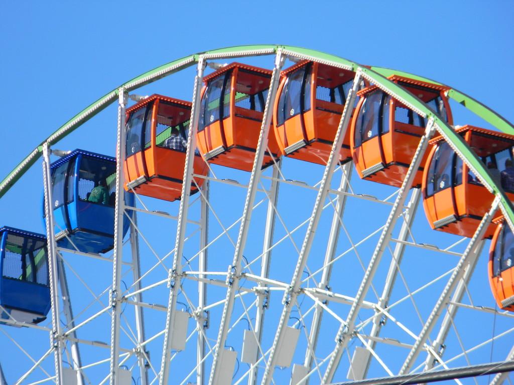 Top of Ferris Wheel with Passengers by sfeldphotos