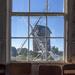 Spocott windmill through schoolhouse window
