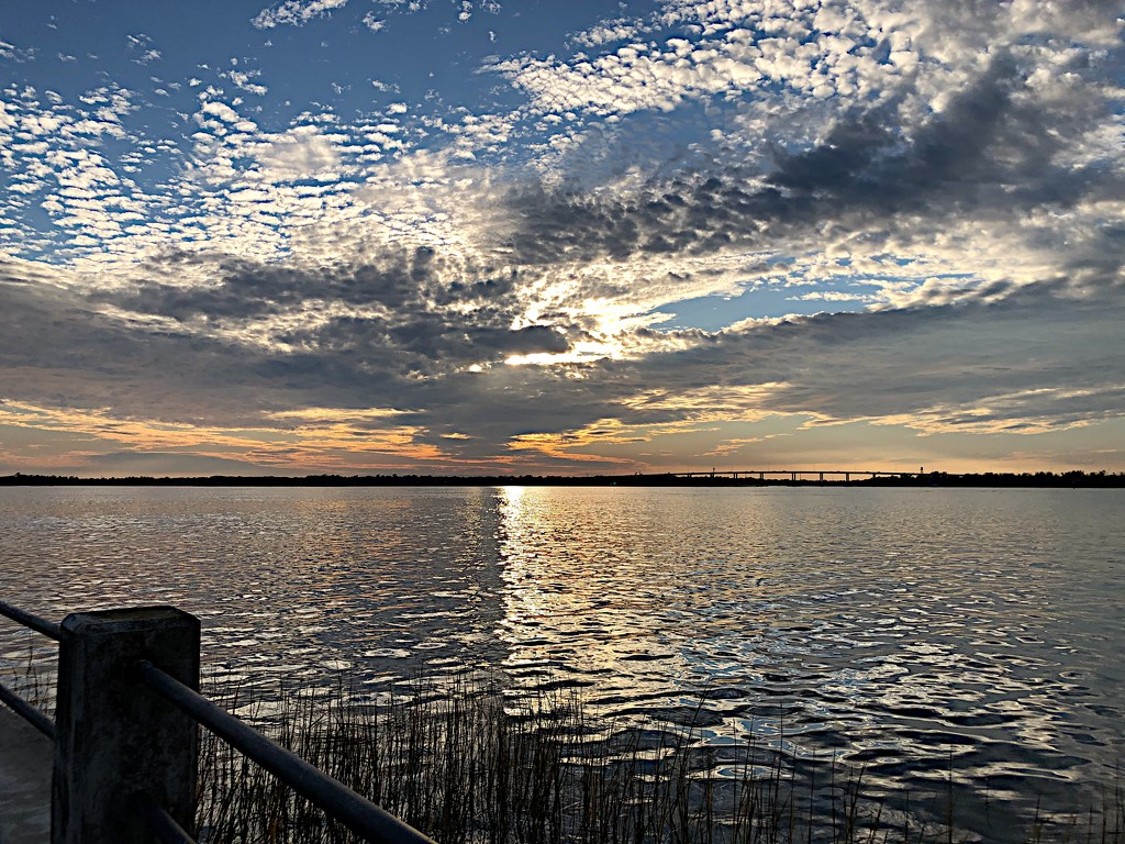 Unusual sky and water at the mouth of the Ashley River at Charleston Harbor. by congaree