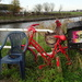 still life with red bicycle