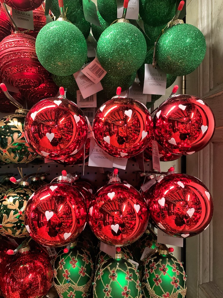 White hearts on red baubles.  by cocobella