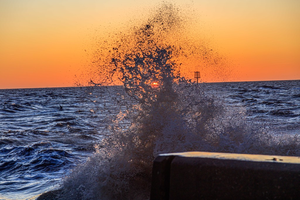 Sunset swallowed by incoming tide by padlock