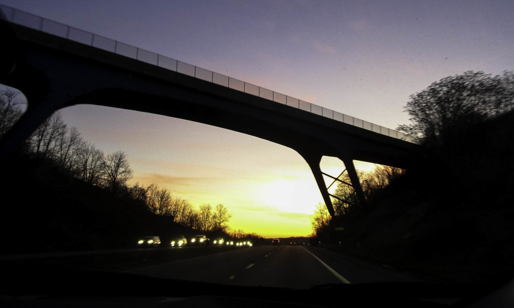 Pretty sky through the bridge by mittens