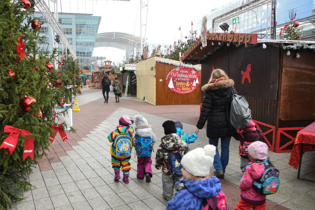 Munich Children Stroll Through Christmas Market by kareenking