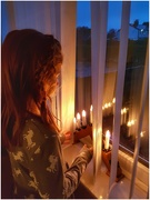 15th Dec 2019 - A visit from the grandchildren today and just caught my eldest parting the blinds to look at the candle display.
