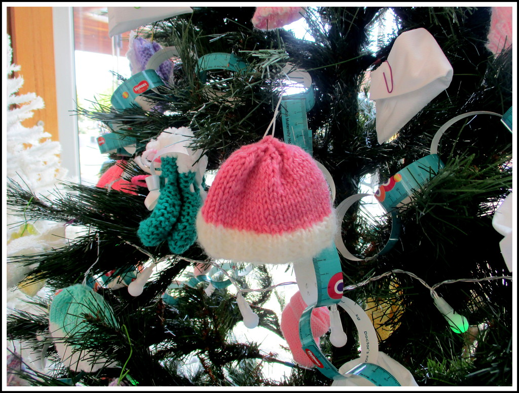 Baby bonnets & baby booties decorated this tree by 777margo