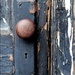 A Door Knob with Peeling Paint by olivetreeann