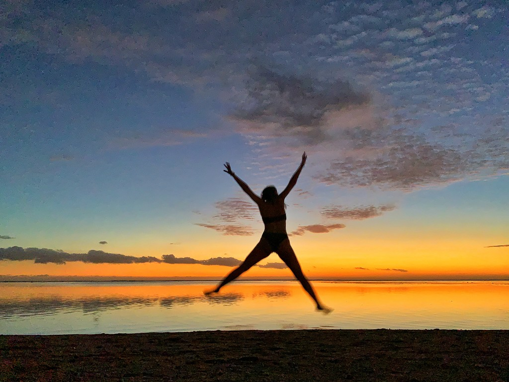 Jump in the sunset by cocobella
