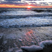Sea foam at sunset