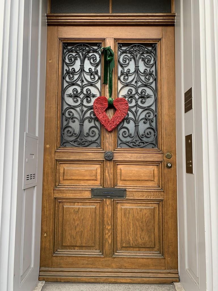 Red heart on a door.  by cocobella