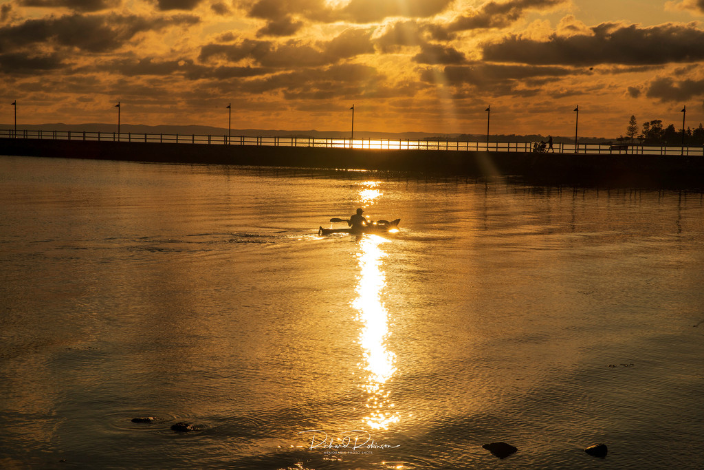 Sunrise Silhouette of a canoeist  by brains970