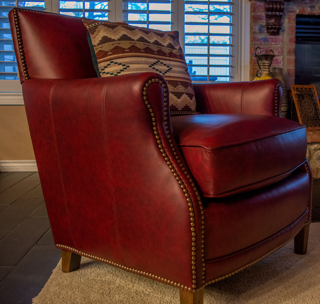 One of Two Red leather chairs  by samae
