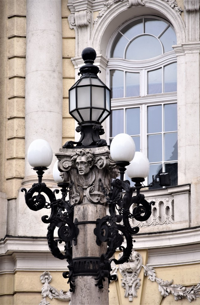 Stylish lamp in front of a theater by kork