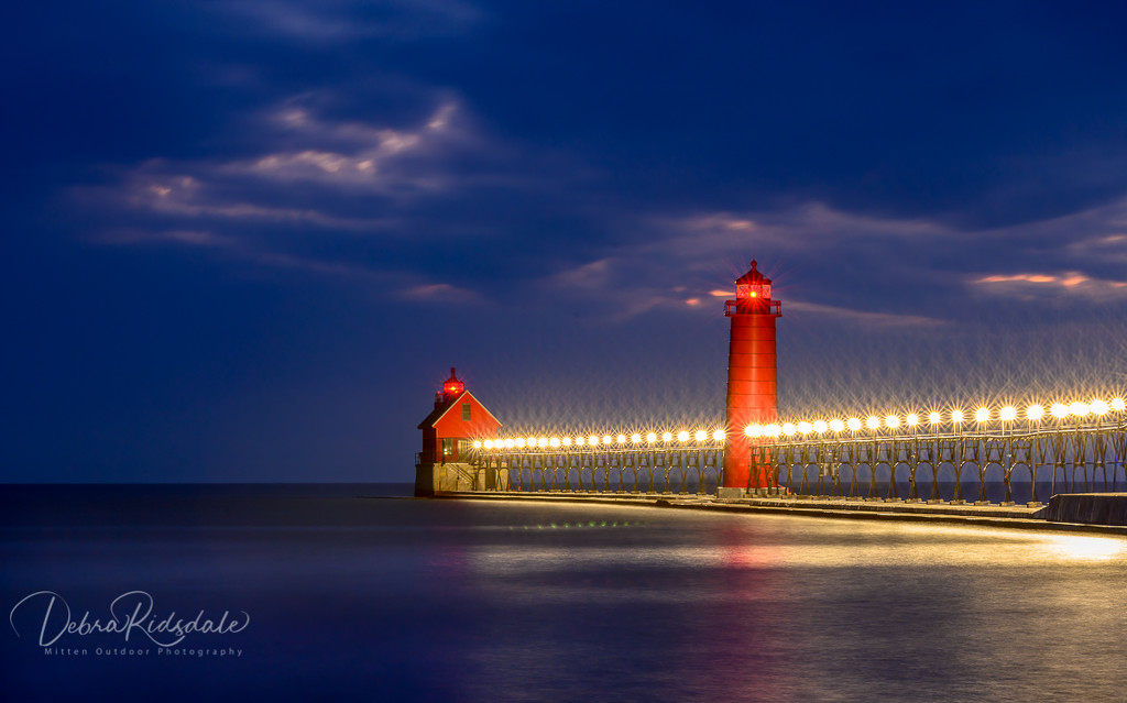 Grand Haven Lighthouse on Lake Michigan  by dridsdale