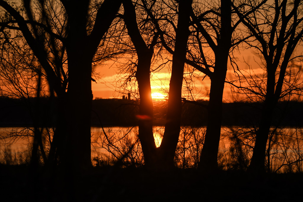 Sun Sets Over Water and Woods by kareenking