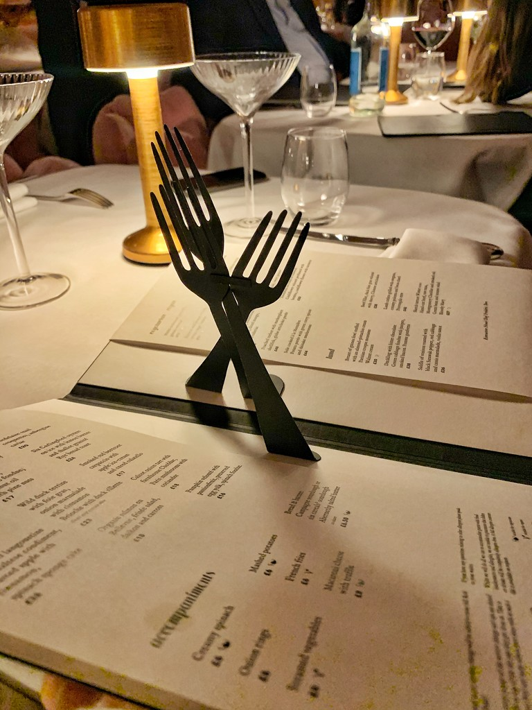 A menu with forks.  by cocobella