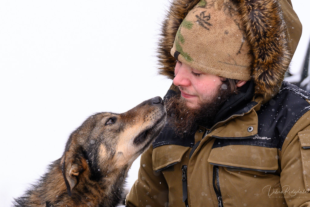The bond between a musher and his sled dog  by dridsdale