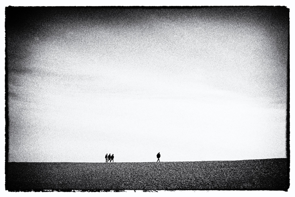 Four figures on Folkestone Beach by seanoneill