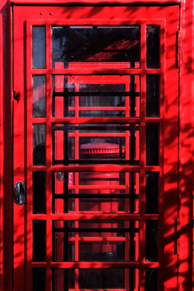 Postbox through a phonebox by 4rky