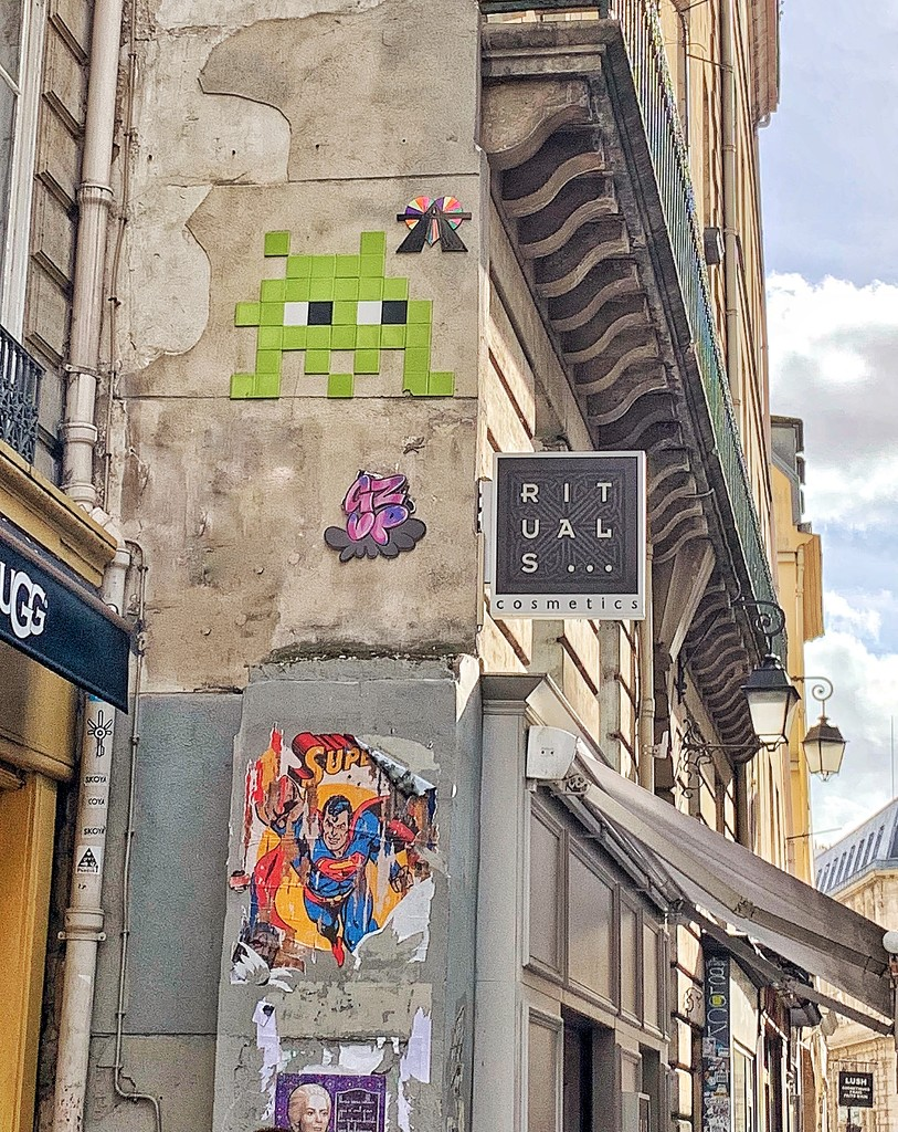 A heart with a A above a space invader.  by cocobella