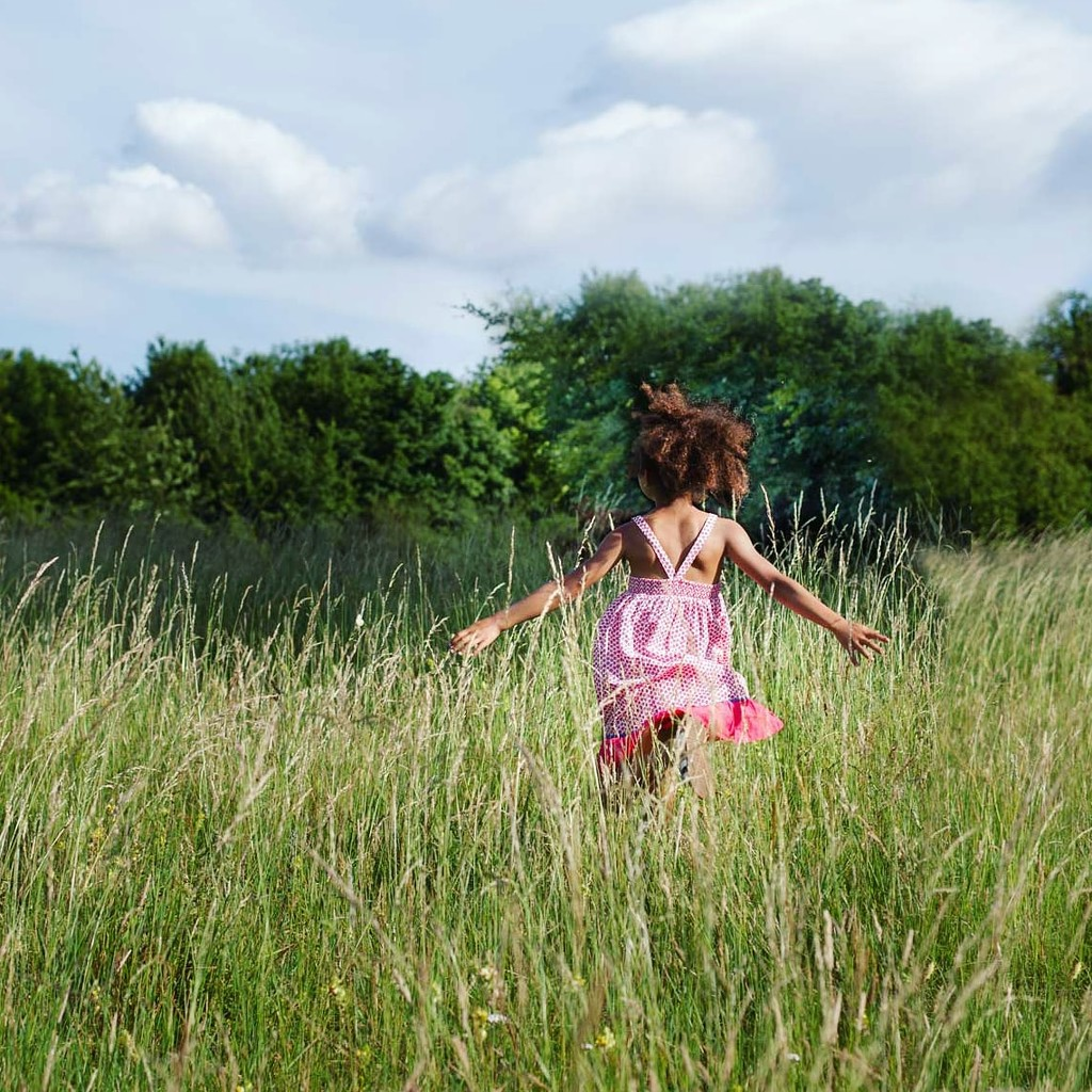 Freedom is running through the grass in the sunshine by pea