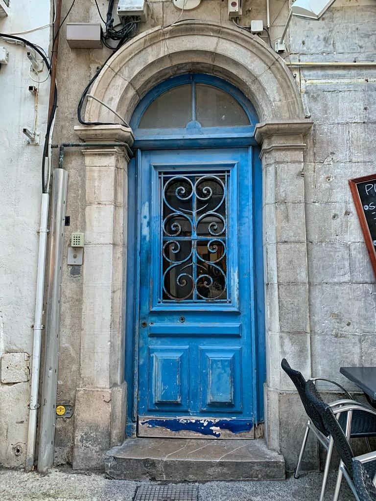 Two hearts on a blue door.  by cocobella