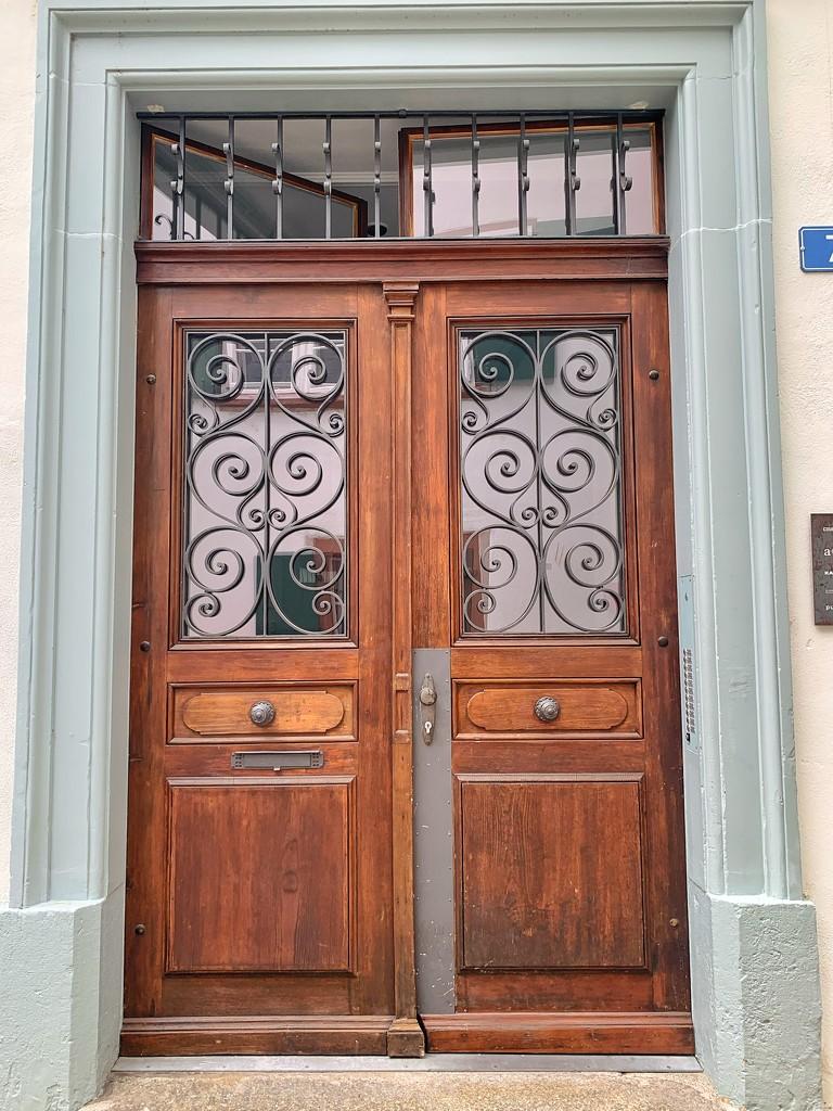 Four hearts on a brown door.  by cocobella