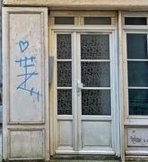 24th Jun 2020 - Blue heart besides a white door.