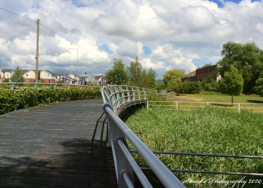 Footbridge to riverside park  by stuart46