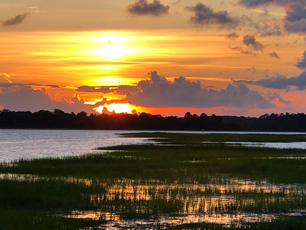 Sunset over the Ashley River and marshes at high tide by congaree